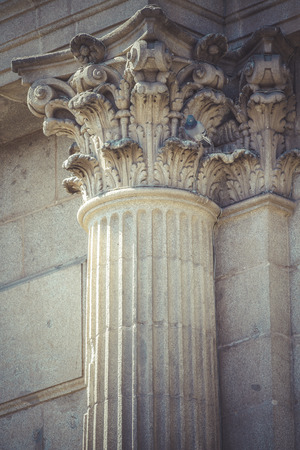 Age, Corinthian capitals, stone columns in old building in Spain photo