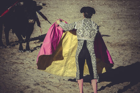 bullfight, traditional Spanish party where a matador fighting a bull photo