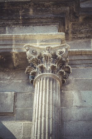 Stonework, Corinthian capitals, stone columns in old building in Spain photo