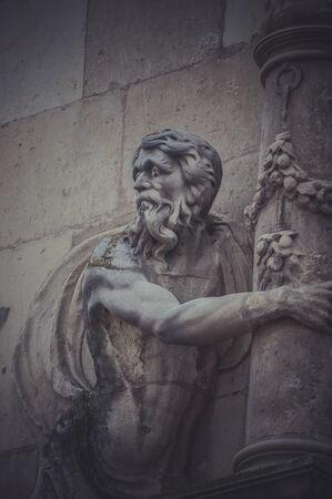 European, Stone gargoyle on the facade of the University of Alcala de Henares, Madrid Spain photo