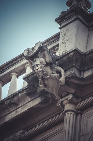 Art, Stone gargoyle on the facade of the University of Alcala de Henares, Madrid Spain photo