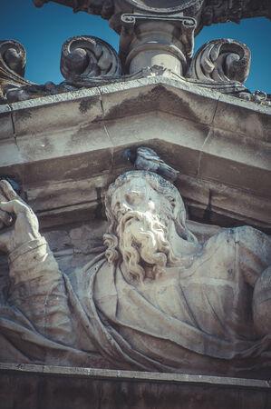 Deity, Stone gargoyle on the facade of the University of Alcala de Henares, Madrid Spain photo
