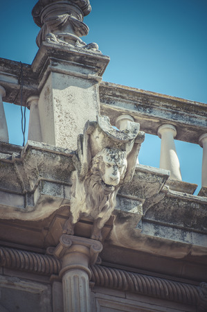 Culture, Stone gargoyle on the facade of the University of Alcala de Henares, Madrid Spain photo
