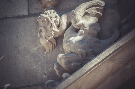 Stone gargoyle on the facade of the University of Alcala de Henares, Madrid Spain photo