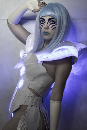 tech woman robot with led light dress, white and blue hair photo