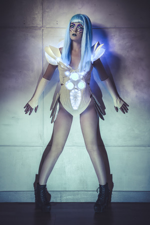 robot woman on wall with blue lights, light suit with neon and LED colors photo