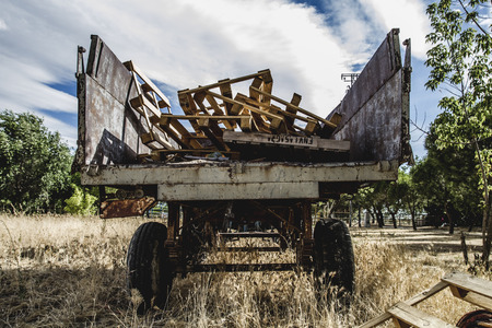 machinery, old agricultural tractor abandoned in a farm field photo