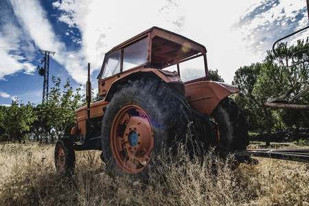 vehicle, old agricultural tractor abandoned in a farm field photo