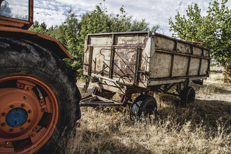 deere: rural, old agricultural tractor abandoned in a farm field Stock Photo