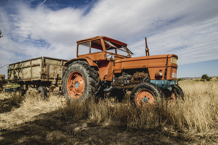 meadow, old agricultural tractor abandoned in a farm field photo