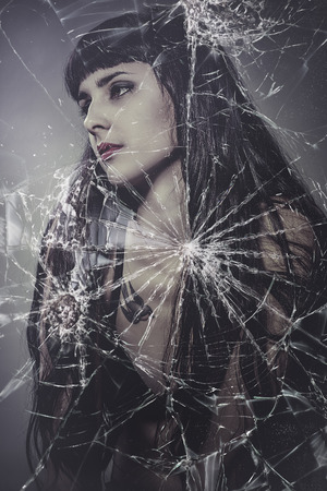 broken glass, beautiful brunette woman with very long hair photo