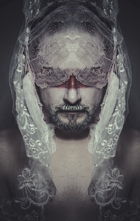 duality veiled mystery man in the face and red painted mask photo