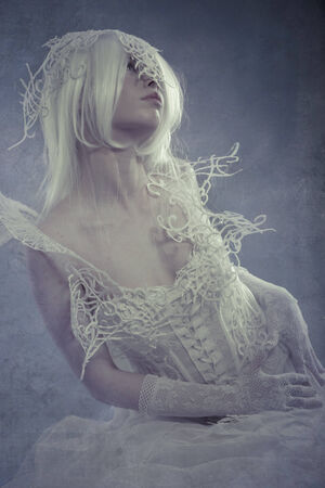 beautiful white-haired woman with gothic dress over rusty background photo