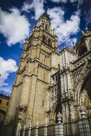 majestic Cathedral of Toledo Gothic style, with walls full of religious sculptures photo
