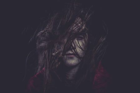 Insomnia, Young girl with hair flying, concept nightmares photo