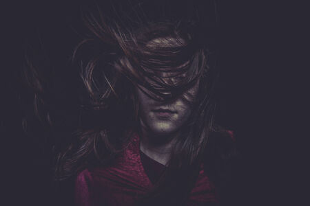 Blood, Young girl with hair flying, concept nightmares photo