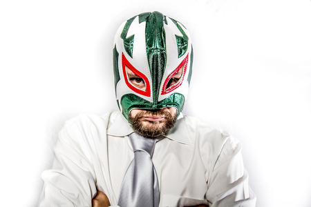 senior, aggressive businessman with Mexican warrior mask photo