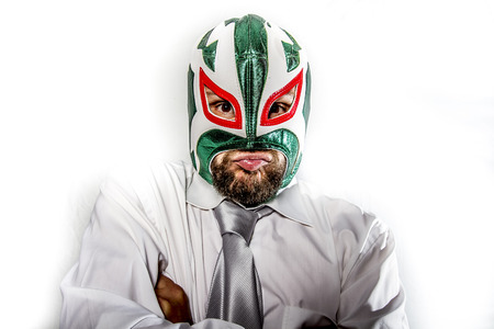 job, aggressive businessman with Mexican warrior mask photo