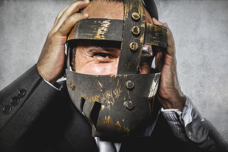 hate, dangerous business man with iron mask and expressions photo