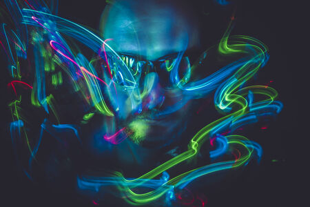 paranormal: paranormal effect lightpainting man with sunglasses and colored lights