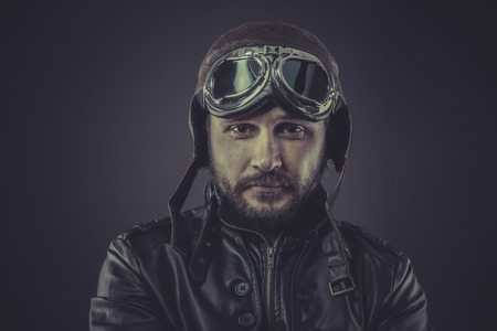 flight helmet: war pilot dressed in vintage style leather cap and goggles Stock Photo