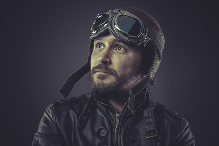 wartime: wartime pilot dressed in vintage style leather cap and goggles Stock Photo