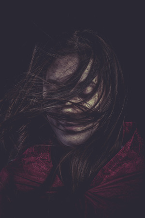 Shock, Young girl with hair flying, concept nightmares photo