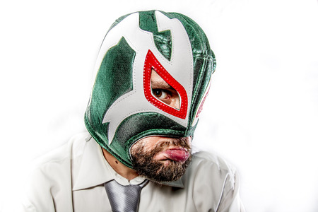 sad, aggressive businessman with Mexican warrior mask photo