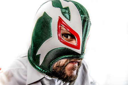 angry, aggressive businessman with Mexican warrior mask photo