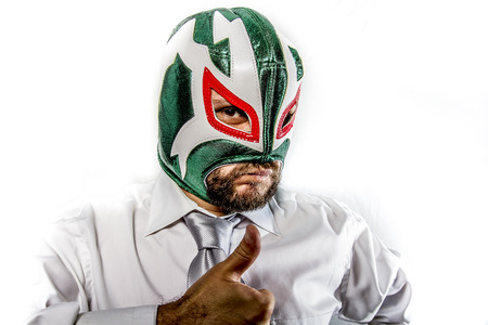 aggressive businessman with Mexican warrior mask photo