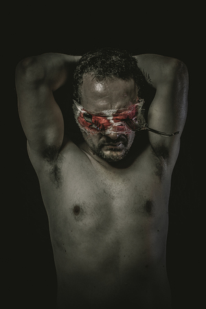 depression man: nightmare, fear, depression, man with his eyes fixed on holders