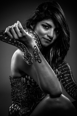 pet  animal: warrior, brunette woman posing with a python snake Australian