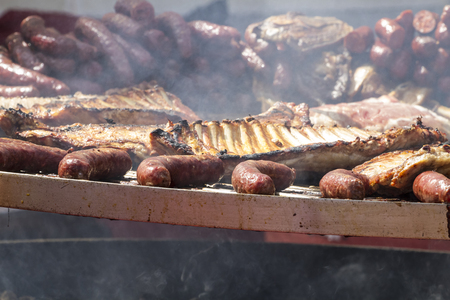 barbecue with sausages and pork sausages photo