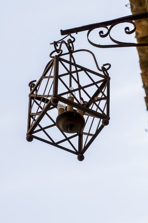 medieval style lamps in the city of Toledo, Spain photo