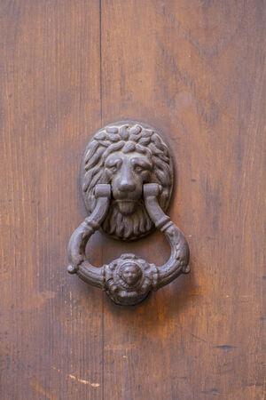 knocker door medieval style in the city of Toledo, Spain photo