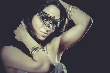 sensuality: Sexy Brunette with venetian mask. sensuality concept