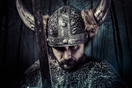 historical periods: Sword, Viking warrior with helmet over vintage textured background