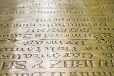 engraved on metal with Spanish writing