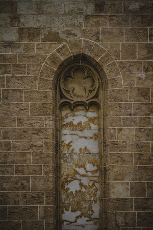 old gothic window, tipical architecture of the Spanish city of Valencia photo