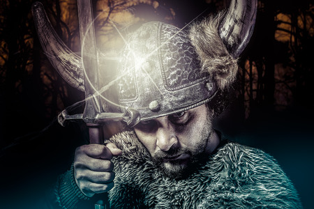viking: War, Viking warrior, male dressed in Barbarian style with sword, bearded