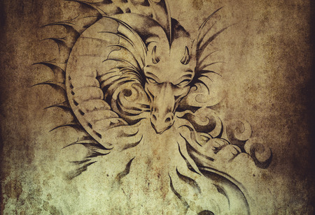 Tattoo art, sketch of a dragon over dirty background photo
