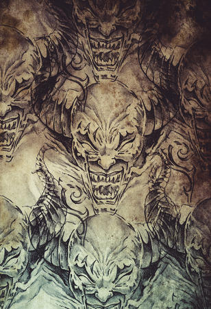 Tattoo pattern with evil designs over antique paper photo