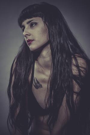 Tattoed, Sensual brunette woman in lingerie photo