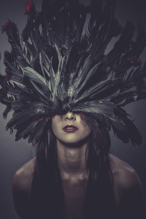 Feathers helmet, Sensual brunette woman in lingerie photo