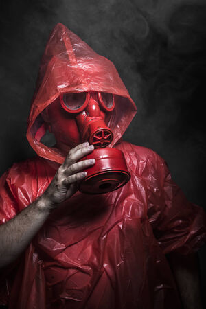 Ecology, nuclear disaster, man with red mask and plastic suit Stock Photo