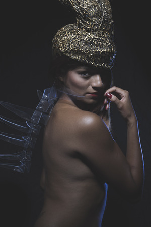 Young Latino woman with golden glass helmet and armor photo