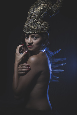 Courage, Latino woman with golden glass helmet and armor photo