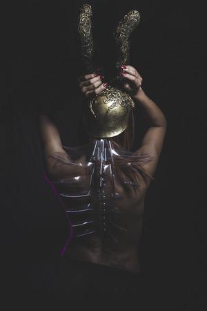 Nude warrior woman with golden helmet photo