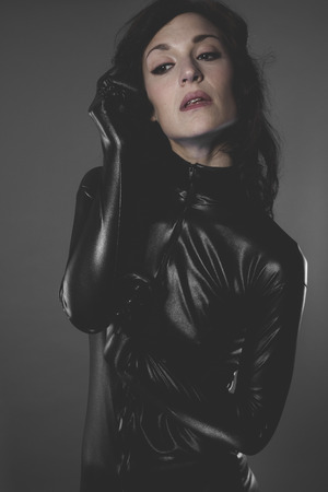 sexy woman dressed in black latex, future concept and new technologies photo