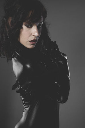 lady, sexy woman dressed in black latex, future concept and new technologies photo